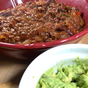 Spicy Beef Chili Close Up with Guacamole