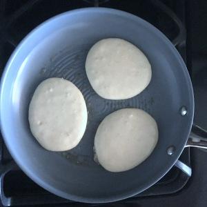 cinnamon-roll-pancakes-in-fry-pan