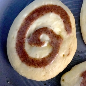 cinnamon-roll-pancakes-in-pan-with-swirl